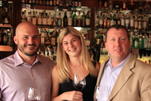 """OIC GM Brent Wittrock, My Favorite Bottle segment """"interviewee"""" Erika Kauffman and MY Favorite Bottle """"host"""" J.P. Gilmore of Vintegrity Wines."""
