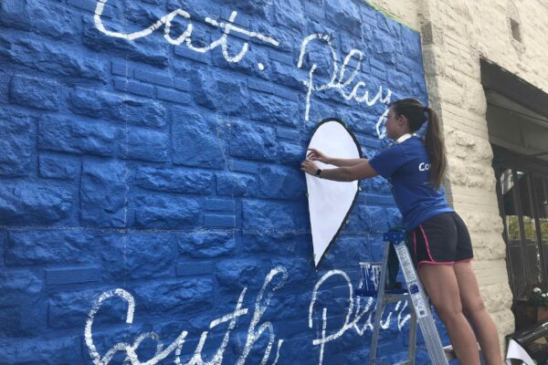 South Plaza Mural - Ruthie laying out heart